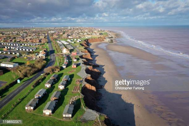 Holiday chalets abandoned due to coastal erosion wait to be demolished or taken by the sea in the village of Withersea in the East Riding of...