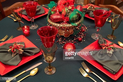Holiday christmas table setting with red green and gold