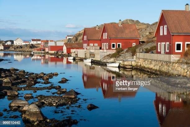 holiday cottages on the fjord, near egersund, rogaland, norway - egersund stock photos and pictures