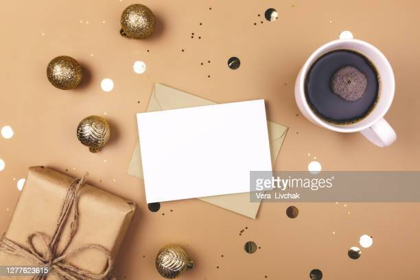 holiday decorations and notebook with 2020 goals on white table, flat lay style. christmas planning concept. - greeting card stock pictures, royalty-free photos & images