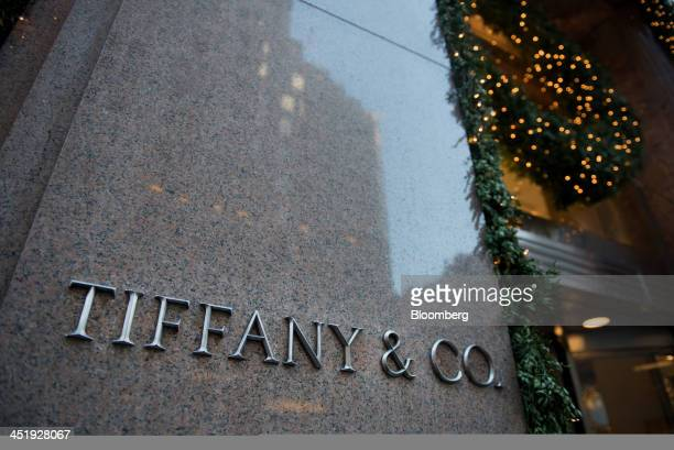 Holiday decorations are displayed outside of a Tiffany Co store in New York US on Sunday Nov 24 2013 Tiffany Co is scheduled to release earnings...