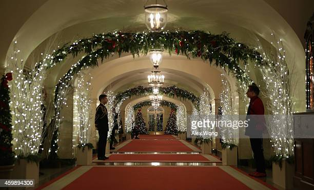 Holiday decorations are seen at a hallway of the White House December 3 2014 in Washington DC The first lady hosted military families to the White...