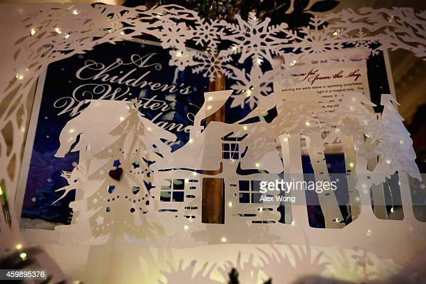 Holiday decorations are seen in the East Room of the White House December 3 2014 in Washington DC The first lady hosted military families to the...