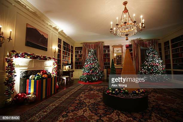 Holiday decorations are seen in the library of the White House November 29 2016 in Washington DC 'The Gift of the Holidays' is the theme of this...