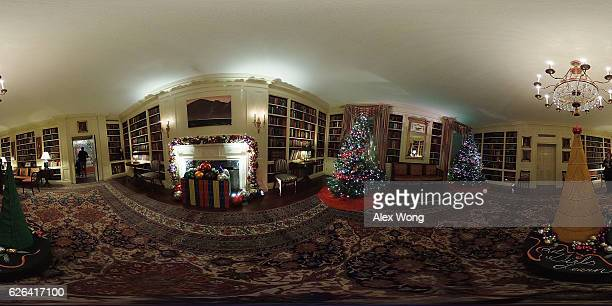 Holiday decorations are seen in the Library of the White House during a press tour November 29 2016 in Washington DC 'The Gift of the Holidays' is...