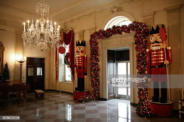 Holiday decorations fill the Grand Foyer entrance at the White House United States First Lady Laura Bush hosted a press preview of the decorations at...