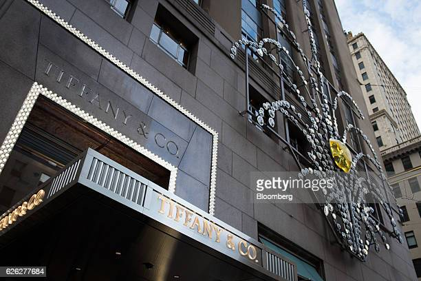 Holiday decorations hang on display outside the Tiffany Co flagship store on Fifth Avenue in New York US on Saturday Nov 26 2016 Tiffany Co is...