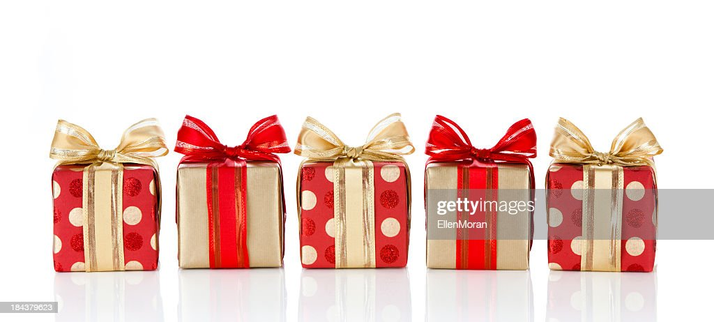 Holiday gifts wrapped in red and gold paper : Stock Photo
