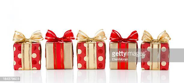 holiday gifts wrapped in red and gold paper - christmas gifts stock photos and pictures