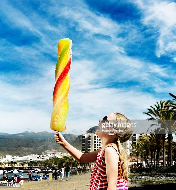 Holiday girl with oversized ice-cream in hand