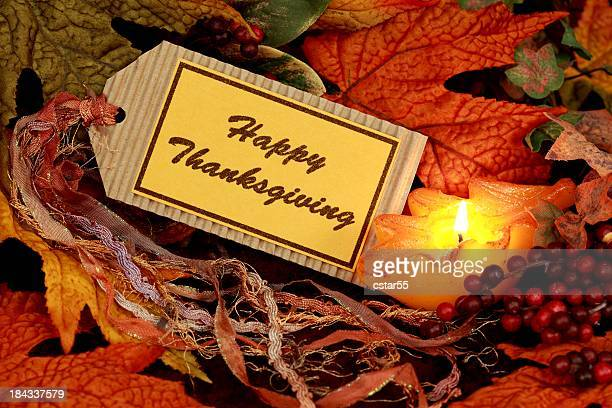 holiday: happy thanksgiving on tag with leaves still life - happy thanksgiving card stock pictures, royalty-free photos & images