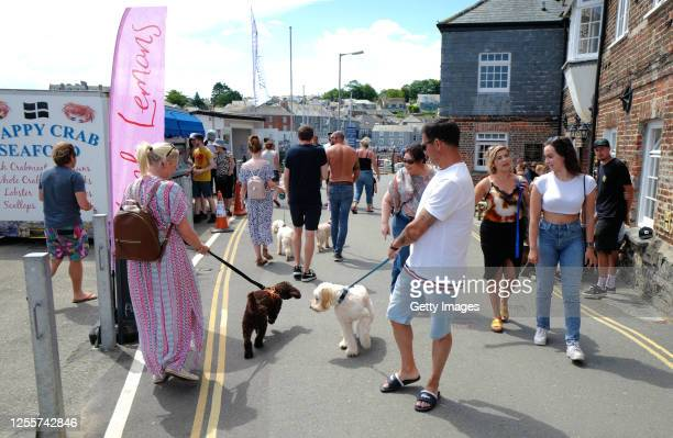 Holiday makers on July 12 2020 in Padstow Cornwall United Kingdom The UK government announced that Pubs Hotels and Restaurants could open from...