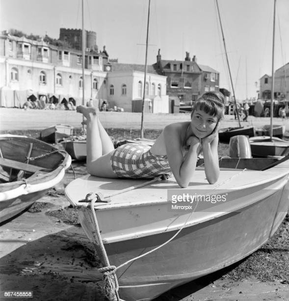 Holiday makers on the beach at Broadstairs enjoying the sunshine A German girl on holiday Ingeborg Filla aged 16 from West Berlin who has come to...