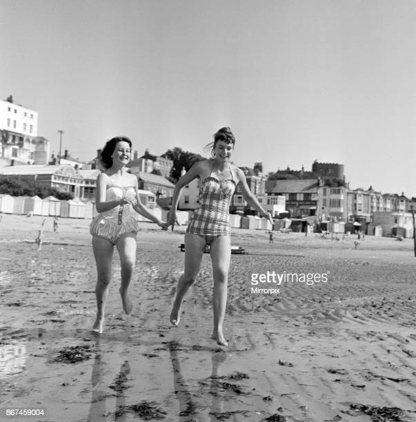 Holiday makers on the beach at Broadstairs enjoying the sunshine Two German girls on holiday Ute Gundlach aged 15 from Kassel and Ingeborg Filla aged...