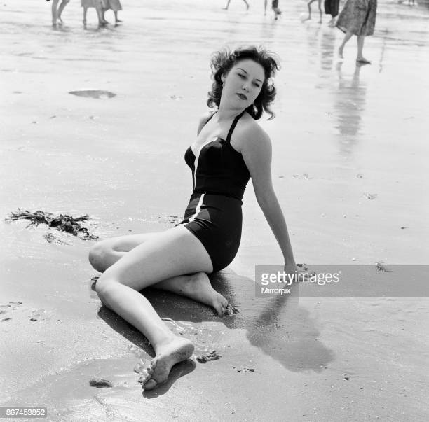 Holiday makers on the beach at Margate enjoying the sunshine Miss Valerie Hodgson aged 17 a shorthand typist from Fulham pictured on Margate beach...