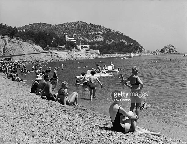 Holiday makers on the beach at Tossa de Mar on the Costa Brava Spain August 1965 The resort is popular with British tourists