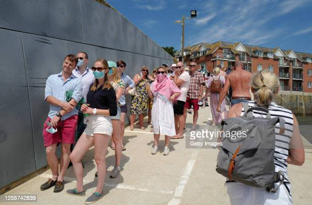 Holiday makers queue for the Padstowrock ferry on July 12 2020 in Padstow Cornwall United Kingdom The UK government announced that Pubs Hotels and...