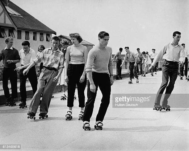 Holiday makers rollerskating at a Butlins Holiday Camp UK | Location Clacton Essex England UK