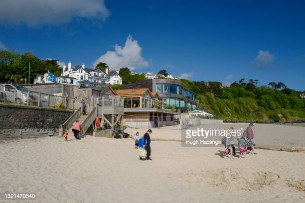 Holiday makers take to the beach in front of the Carbis Bay Hotel, host venue for the G7 Summit conferences, on June 03, 2021 in Carbis Bay,...