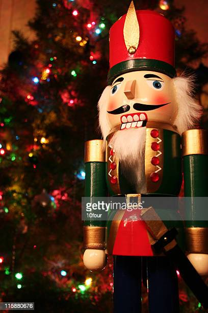 A holiday nutcracker and a Christmas tree on the back