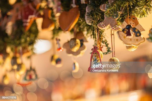 holiday ornaments, gilded walnuts and gingerbread cookies hanging during a holiday market. - angel hot imagens e fotografias de stock