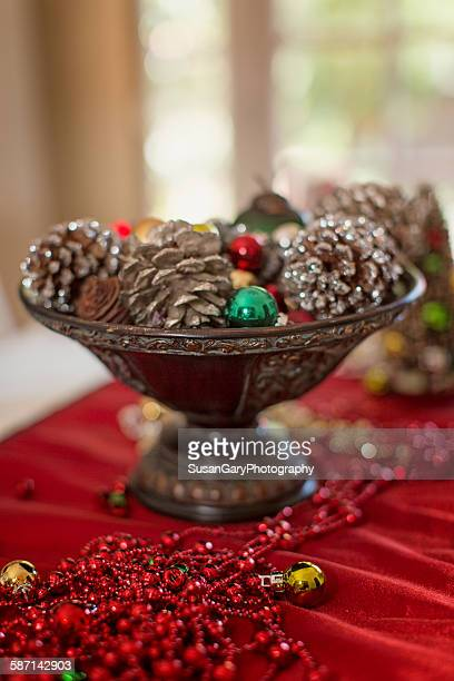 Holiday Ornaments In Wooden Bowl