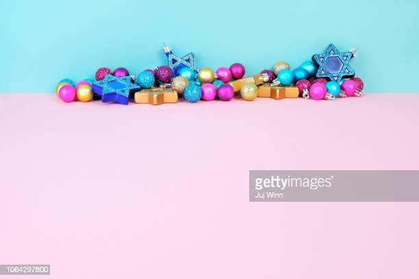 Holiday ornaments on a pink and blue background