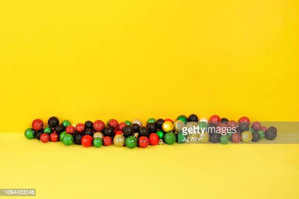 Holiday ornaments on a yellow background