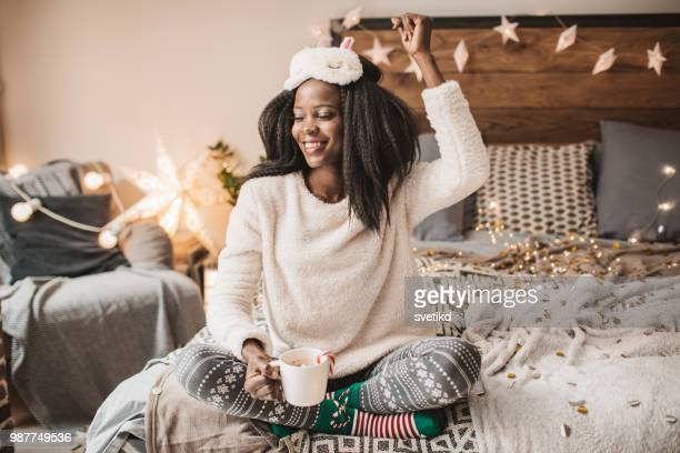 holiday pajama party - pajamas stock pictures, royalty-free photos & images