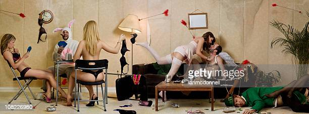 holiday party with leprechaun, easter bunny and cupid - men wearing stockings stock photos and pictures