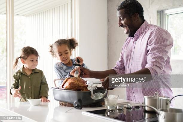 holiday season family and friends multi-ethnic during thanksgiving dinner - canadian thanksgiving stock pictures, royalty-free photos & images