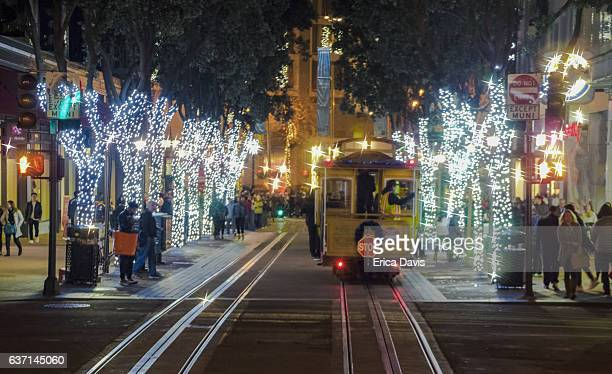 Holiday Season. Group of people enjoying a night of cable car riding and Christmas festivities.