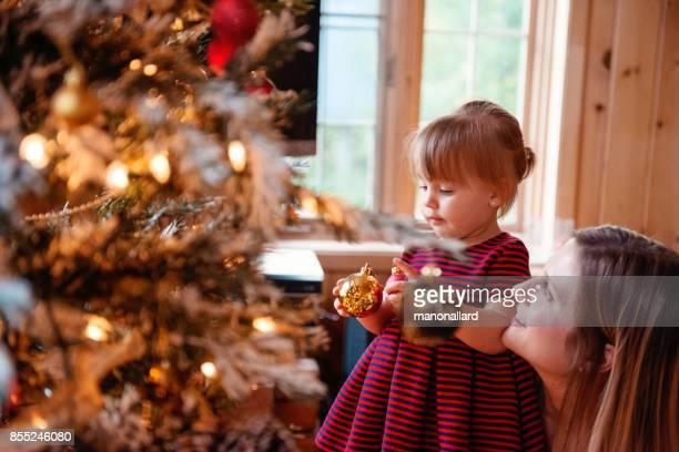 Holiday Season with family around the Christmas Tree