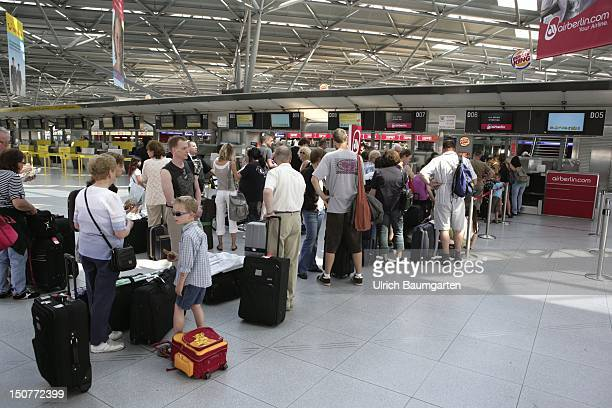 GERMANY COLOGNE Holiday season with many passengers at the checkin counters of Air Berlin at CologneBonn airport