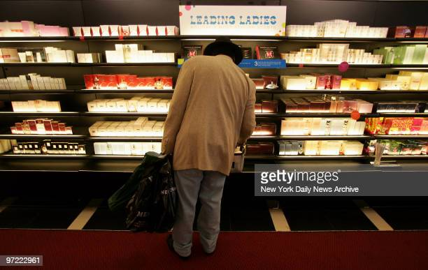 A holiday shopper looks over a perfume display at the Sephora store on W 34th St