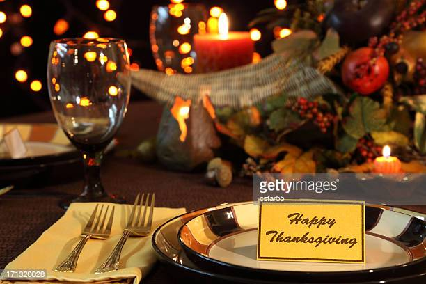 Holiday: Thanksgiving Table setting with cornucopia, candles