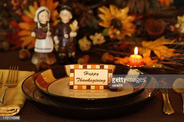 holiday: thanksgiving table setting with fall flowers, pilgrims, candle - happy thanksgiving card stock pictures, royalty-free photos & images