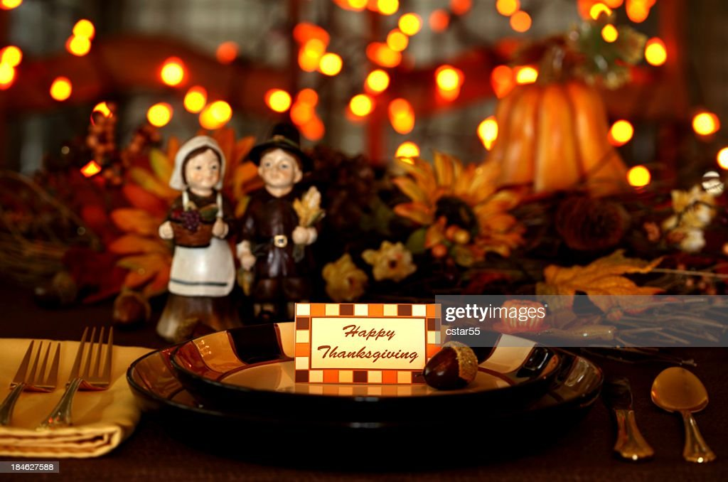 Holiday: Thanksgiving Table setting with pilgrims and lights : Stock Photo