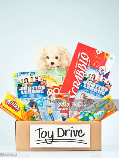 holiday toy drive - toys for tots stock pictures, royalty-free photos & images