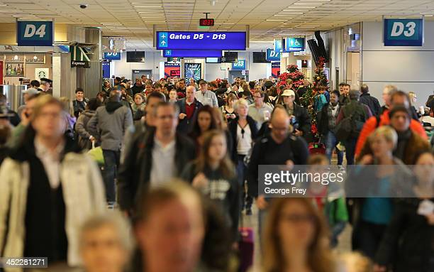 Holiday travelers make their way through the Salt Lake City international Airport on November 27 2013 in Salt Lake City Utah A wintry storm system...