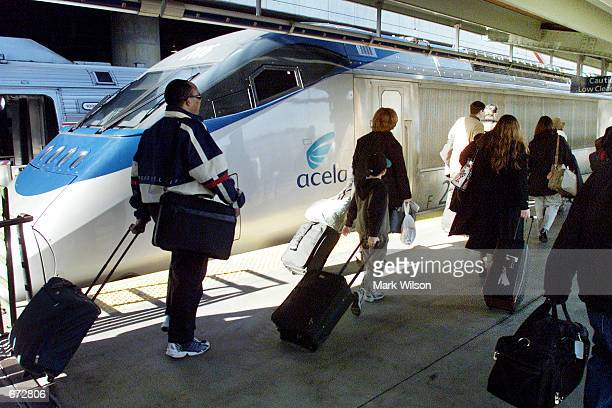 Holiday travelers prepare to board an Amtrak Acela train at Union Station November 21 2001 in Washington DC Many travelers expressed confidence while...