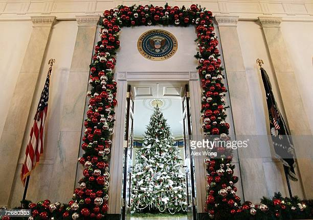 A holiday tree is seen in the Blue Room of the White House from the entrance during a media preview of the White House holiday decorations November...