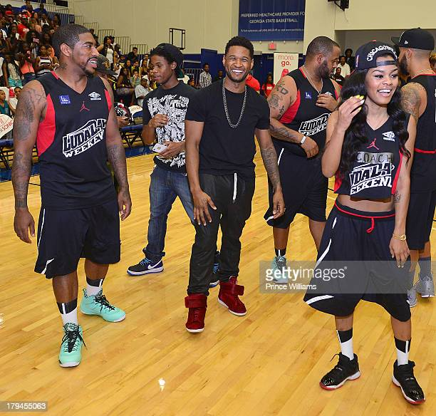 Holiday Usher and Teyana Taylor attend LudaDay Weekend Celebrity Basketball Game at Georgia State University on September 1 2013 in Atlanta Georgia
