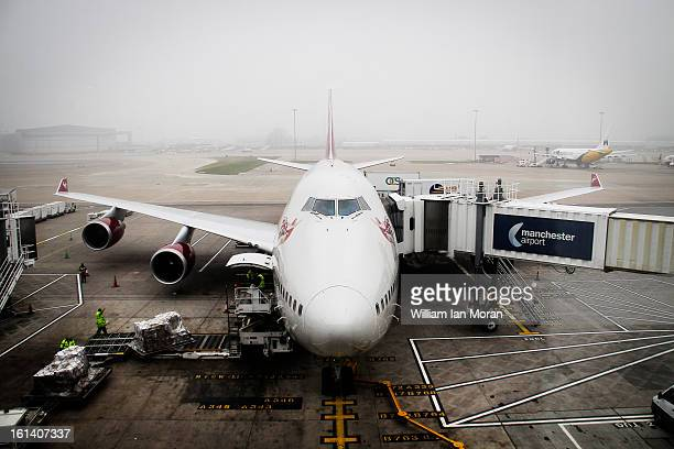 Holiday vacation, loading airplane to Florida 2012, on a foggy day at Manchester International Airport