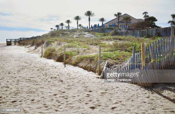 holiday villas at the ocean beach - arman zhenikeyev stock pictures, royalty-free photos & images