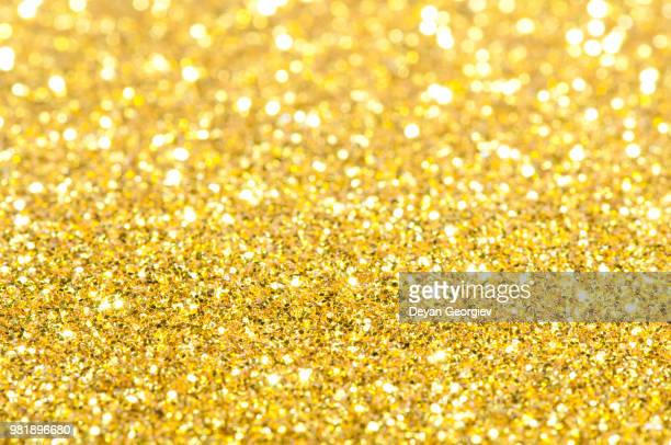 holiday yellow shiny background - christmas background stock photos and pictures