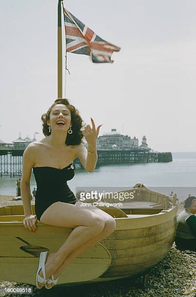 A holidaymaker on the beach at Blackpool Lancashire July 1954 Blackpool pier is in the background Original publication Picture Post 7227 Blackpool...