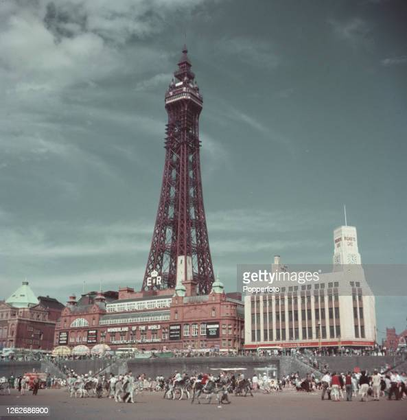 Holidaymakers and visitors enjoy a day on the beach with donkey rides at the seaside resort of Blackpool in Lancashire in August 1953 In the...