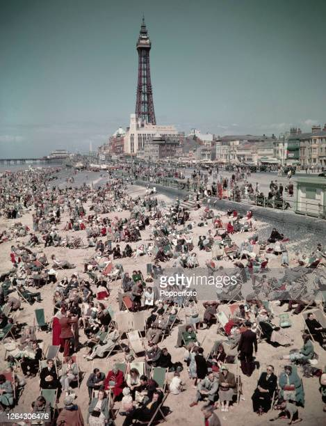 Holidaymakers and visitors many seated in deck chairs enjoy a day on the beach at the seaside resort of Blackpool in Lancashire in August 1952 In the...