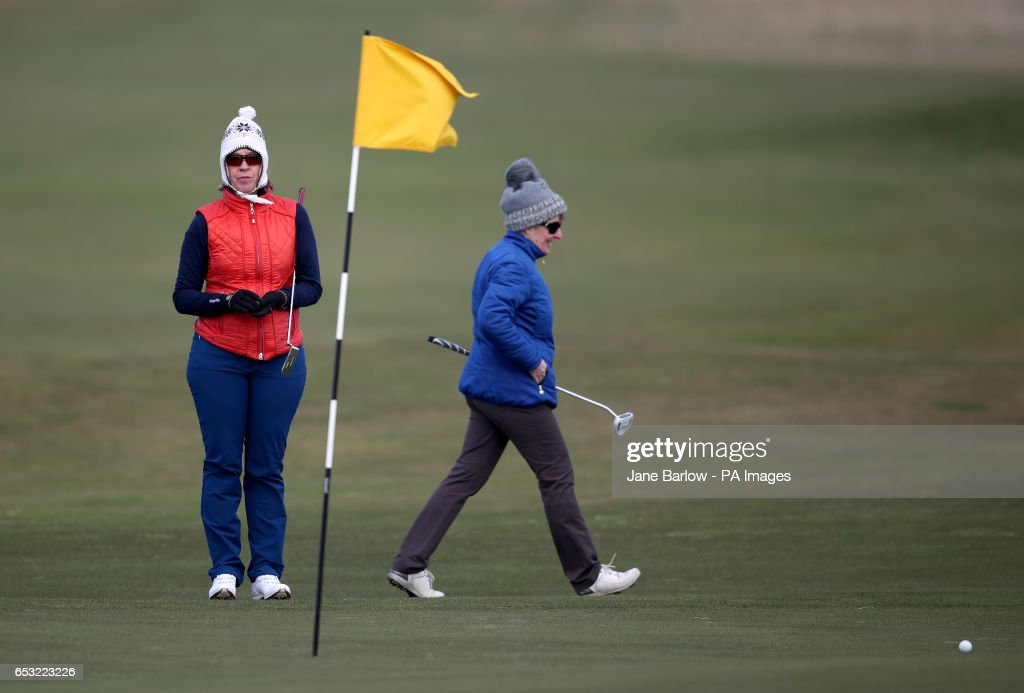 Holidaymakers Anna Dietrich (left) and Jeanette Siehenthiler on the 18th hole at Muirfield, following the announcement that women will be admitted as members after a ballot was held by The Honourable Company of Edinburgh Golfers.